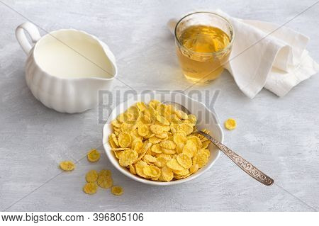 Sweet Crunchy Cornflakes With Apple Juice On A Gray Textured Background. Fast Tasty Breakfast, Horiz