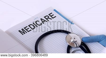 Medicare . Notepad With Text In Hand Of Medicine With Stethoscope