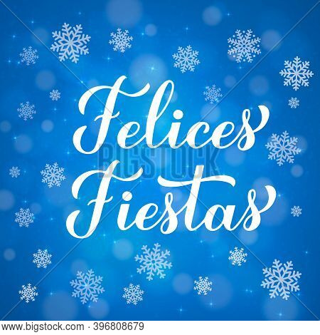 Felices Fiestas Calligraphy Hand Lettering On Blue Background With Bokeh And Snowflakes.. Happy Holi