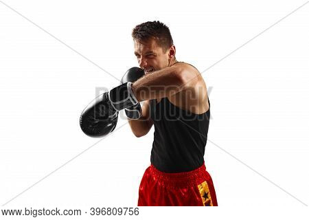 Boxer Man In Black Boxing Gloves Punching Isolated On White Background.