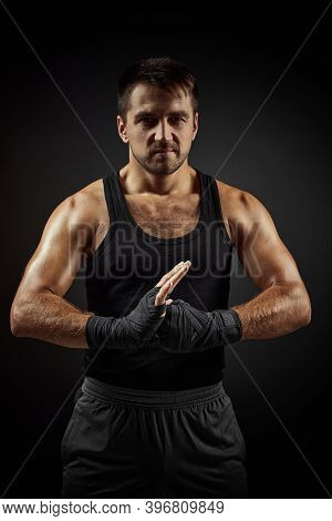 Muscular Sporty Handsome Man In Boxing Bandage On Black Backgrround