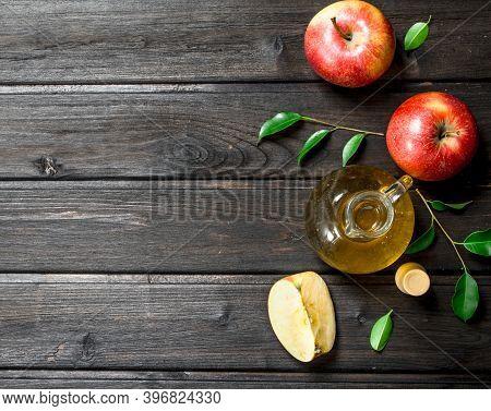 Apple Cider Vinegar With Fresh Apples. On Wooden Background.