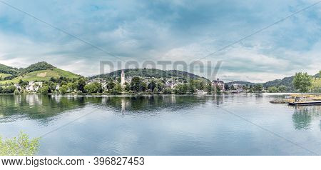 Scenic View To Bullay In The Moselle Valley With Vineyards And Calm River