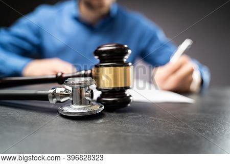 Medical Malpractice Litigation Law. Lawyer Or Judge In Courtroom