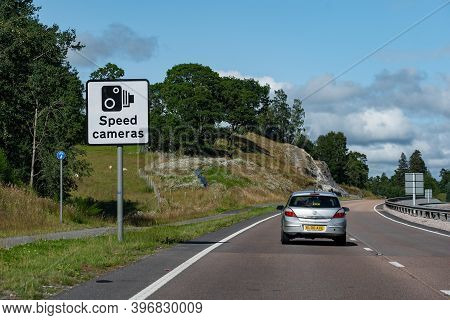 Scotland - August 8, 2019: Vauxhall Astra Car At Scottish Highway With A Speed Cameras Traffic Sign