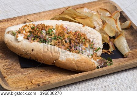 Hotdog With Ketchup, Mustard, Cucumber Relish And Red Onion, Wood Background