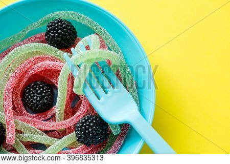 Closeup of colorful jelly worms shown as spaghetti