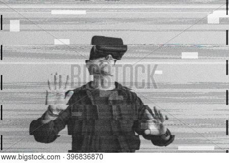 Man using VR on digital glitch background