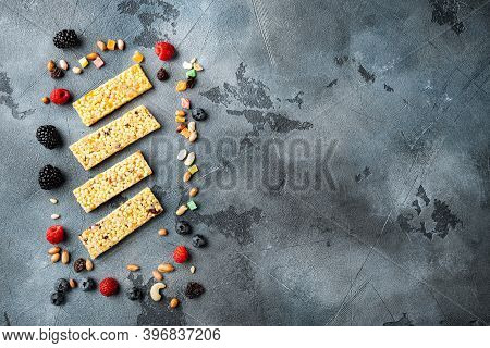 Superfood Breakfast Bars With Oats Nuts And Berries, Top View With Copy Space, On Grey Background