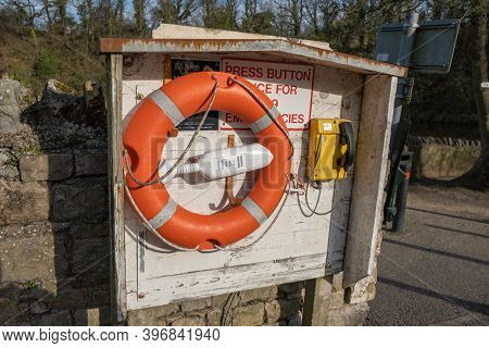 Richmond, North Yorkshire, Uk - March 23, 2020: An Emergency Point With An Orange Lifebuoy Next To T