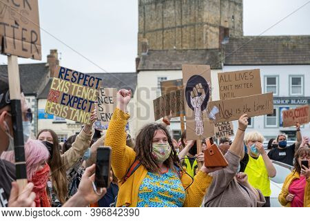 Richmond, North Yorkshire, Uk - June 14, 2020: Protesters Wearing Face Masks Hold Black Lives Matter