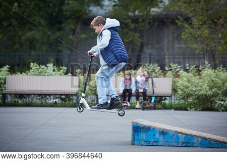 The Guy In The Jump On The Kick Scooter