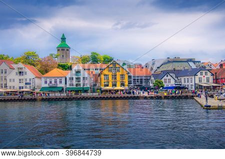 Stavanger, Norway - August 2, 2018: City Street View With People, Harbour And Colorful Traditional W