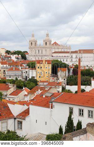 Lisbon Cityscape With Monastery Of Sao Vicente De Fora - Alfama Neighborhood. Rainy Weather.