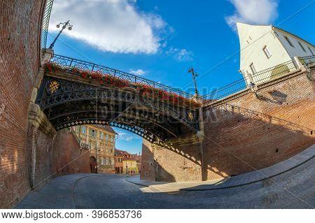 Sibiu, Romania - July 8, 2020: View To The Bridge Of Lies, The First Cast Iron Bridge Built In Roman