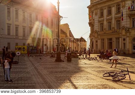 Sibiu, Transylvania, Romania - July 8, 2020: Twilight Light In The Great Square Of The City, With To