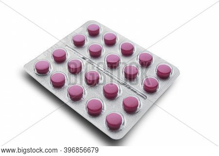 Aluminum Foil-covered Blister Pack With Pink Tablets Isolated On A White Background