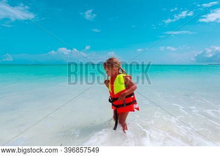 Little Girl In Life Jacket On Beach, Kids Safety Concept