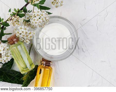Closeup Shot Of Organic Oil And Cream. Green Cosmetic Arrangement, Fresh Herbal Skincare Cosmetics.