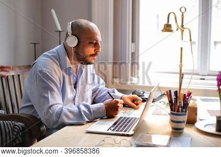 man works at home with computer
