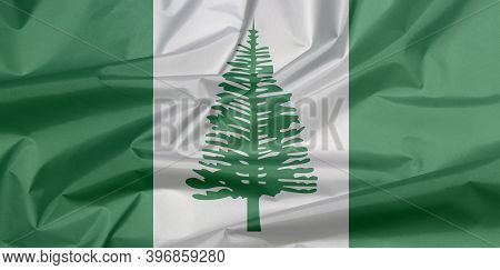Fabric Flag Of Norfolk Island. Crease Of Norfolk Flag Background, Norfolk Island Pine In A Central W