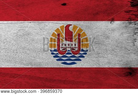 Flag Of French Polynesia On Wooden Plate Background. Grunge French Polynesia Flag Texture. Two Red H
