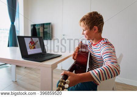 Kid Having Guitar Lesson Online, Teenage Boy On Remote Music Lesson