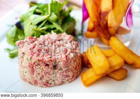 Tasty Steak tartare (Raw beef) - classic steak tartare on white plate