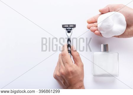 Hands Holding Razor Blade And Shaving Foam, With After Shave Isolated  On White Background, With Cop