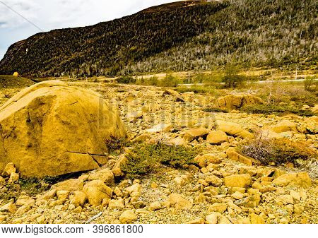 Yellow Rock Formations Of The Table Lands. Gros Morne National Park, Newfoundland, Canada