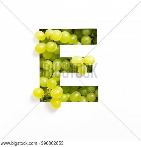 Letter E Of English Alphabet Of Green Grape And Cut Paper Isolated On White. Typeface Made Of Fresh
