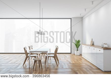 White And Wooden Dining Room With Minimalist White Chairs And White Table. Light Design Of Eating Ro