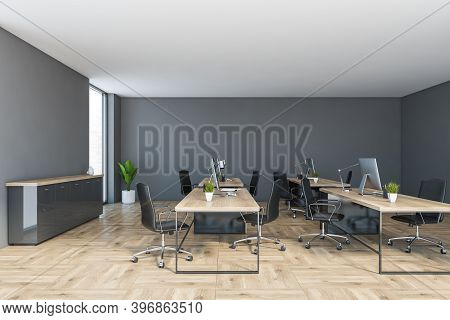 Grey And Wooden Office Room With Computers On Tables And Black Chairs, Consulting Room. Open Space W