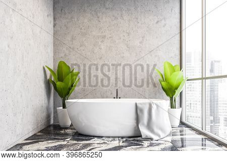 Interior Of Modern Bathroom With Concrete Walls, Marble Floor And Comfortable Bathtub. 3d Rendering