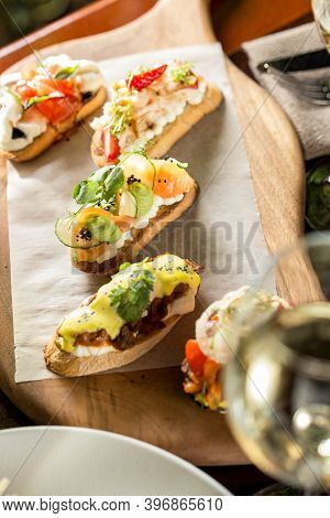 Brushetta Bread Sandwich Snack Authentic Traditional Spanish Tapas On Wooden Plate At The Restaurant