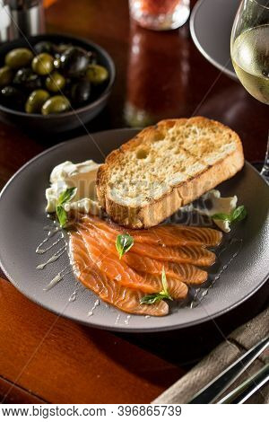 Delicious Homemade Smoked Salmon Slices With Toasted Bread And Cream Cheese On Wooden Table At Resta