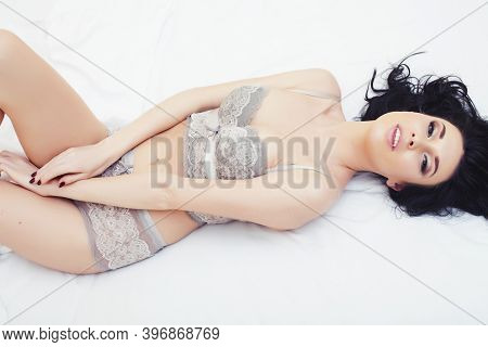 Sexy Beautiful Brunette Woman Lying In Bed In Sensual Gray Lingerie, Looking At Camera. Seduction Co