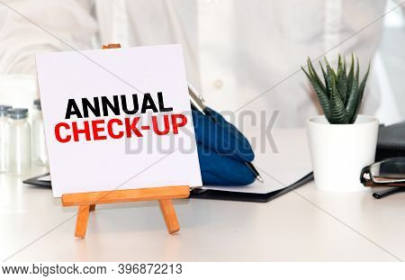 Annual Check-up Text On Paper With Heart Beat Diagram, Stethoscope, Delicious Green Apple, Measureme