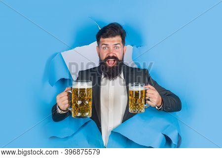 Drinks, Alcohol, Bar. Bearded Man Holds Mug Of Beer. Man Drinks Beer. Lager And Dark Beer. Bearded M