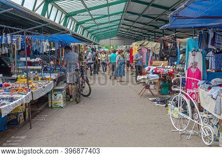 Novi Sad, Serbia - June 2, 2018: People Shopping At Indoor Hall Flea Market In Novi Sad, Serbia.