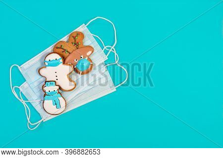 Funny Christmas Ginger Cookies In Protective Masks And Medical Masks On A Blue Background. Concept O