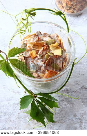 Granola With Yogurt In A Clear Glass On A Light Background. Healthy Low-calorie Food. Natural Produc