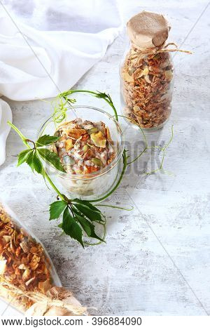 Granola With Yogurt In A Clear Glass On A Light Background. Muesli In Glass Bottles. Healthy Low-cal