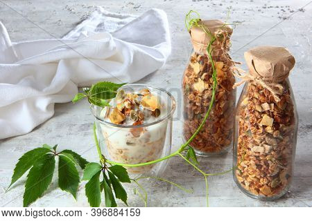 Muesli With Yogurt In A Clear Glass On A Light Background. Granola In A Glass Bottle. Healthy Low-ca
