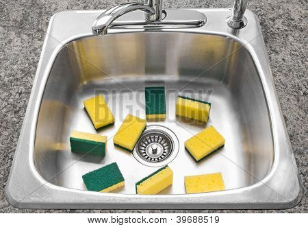 Lots Of Yellow Sponges In A Clean Kitchen Sink