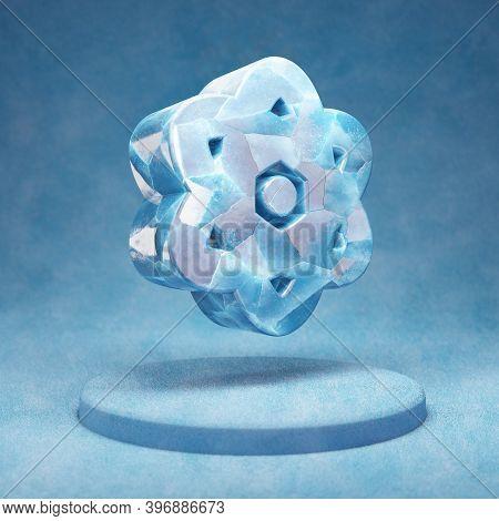 Atom Icon. Cracked Blue Ice Atom Symbol On Blue Snow Podium. Social Media Icon For Website, Presenta