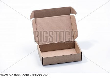 Cardboard Platter Box Isolated On A Yellow Background. Carton Packaging Box