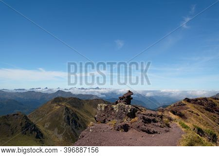 Stone Landmark At The Top Of Ayous Peak With Views Of The Peaks And Mountains Of The Pyrenees With S