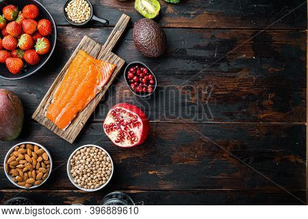 Organic Food For Healthy Nutrition And Superfoods, Flat Lay On Dark Wooden Background, With Space Fo