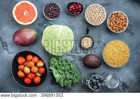 Organic Food For Healthy Nutrition And Superfoods, Flat Lay, On Grey Background